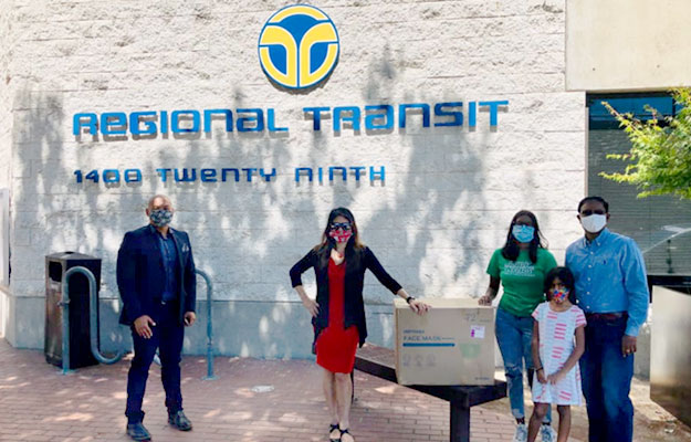 Treasurer Ma and representatives of the Asian Pacific Islander American Public Affairs organization delivering protective masks to the Sacramento Regional Transit District office